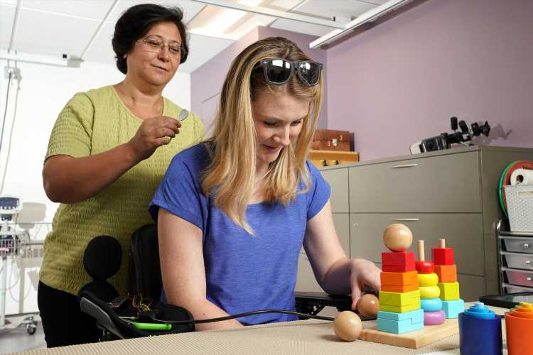 New treatment allows some people with spinal cord injury to regain hand and arm function